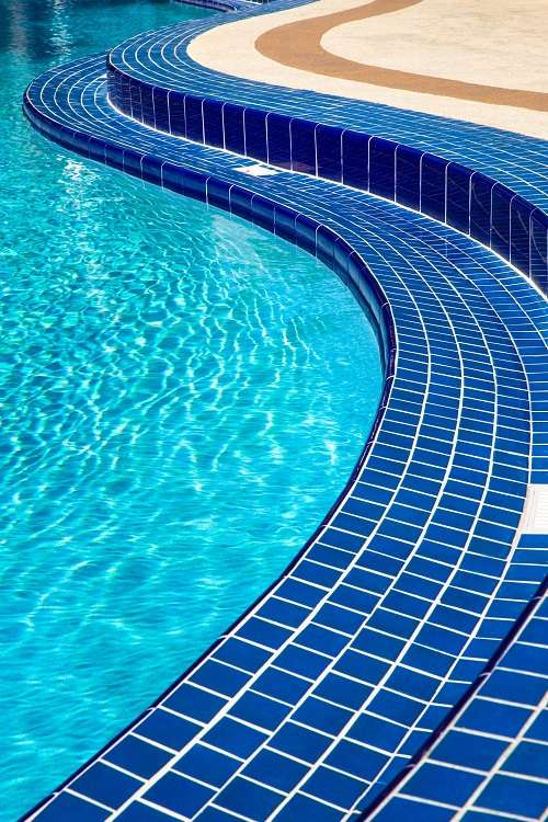 Swimming pool with blue tiles